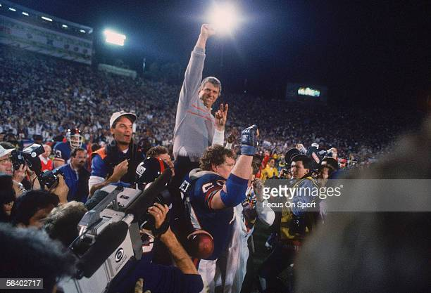 Head coach Bill Parcells of the New York Giants raises his fist in victory as he is carried off the field after defeating the Denver Broncos during...