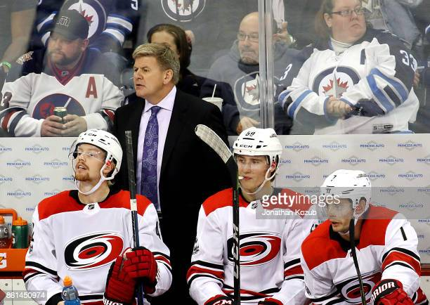Head Coach Bill Peters of the Carolina Hurricanes looks on from the bench during third period action against the Winnipeg Jets at the Bell MTS Place...