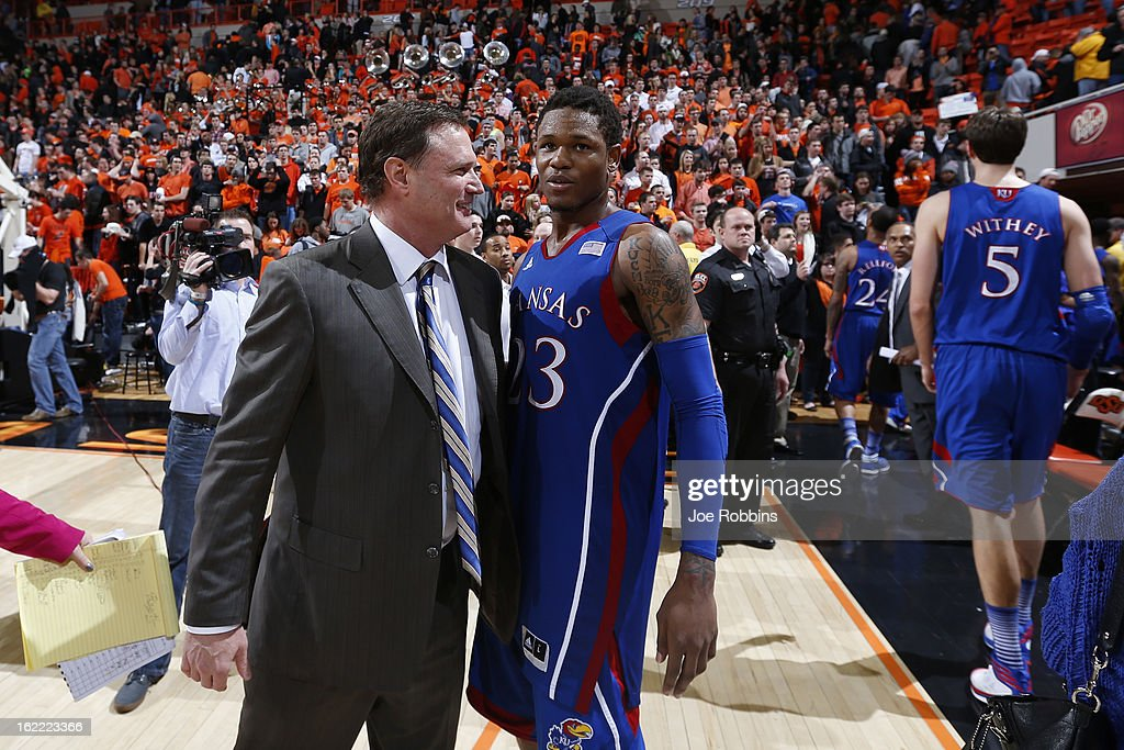 Head coach Bill Self and <a gi-track='captionPersonalityLinkClicked' href=/galleries/search?phrase=Ben+McLemore&family=editorial&specificpeople=9966388 ng-click='$event.stopPropagation()'>Ben McLemore</a> #23 of the Kansas Jayhawks celebrate after the game against the Oklahoma State Cowboys at Gallagher-Iba Arena on February 20, 2013 in Stillwater, Oklahoma. Kansas won 68-67 in two overtimes.