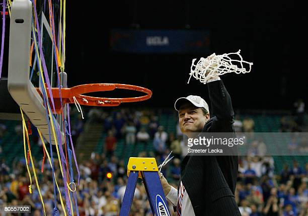 Head coach Bill Self of the Kansas Jayhawks celebrates by cutting down the nets after defeating the Memphis Tigers 7568 in overtime during the 2008...