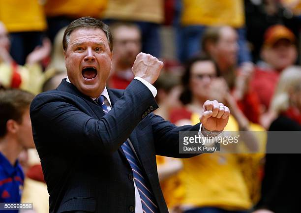 Head coach Bill Self of the Kansas Jayhawks coaches from the bench in the first half of play against the Iowa State Cyclones at Hilton Coliseum on...