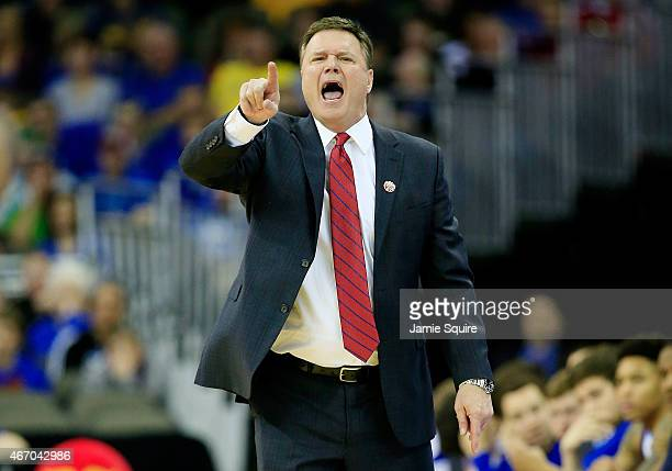Head coach Bill Self of the Kansas Jayhawks looks on from the sideline against the New Mexico State Aggies during the second round of the 2015 NCAA...