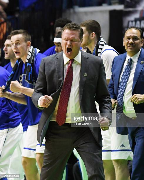 Head coach Bill Self of the Kansas Jayhawks reacts late in the game of his teams victory over the Michigan State Spartans during the second round of...