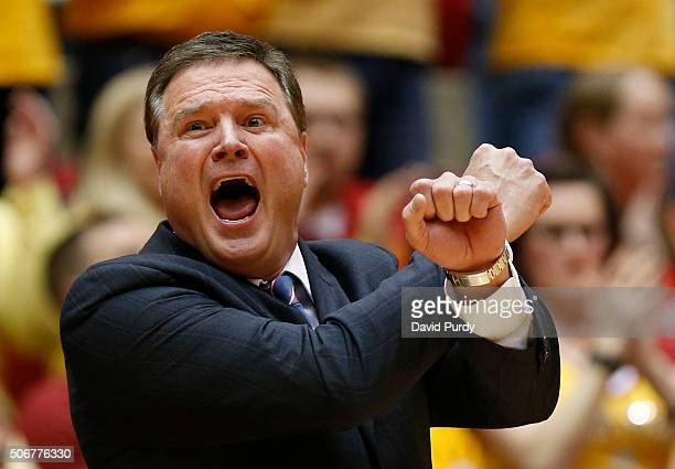Head coach Bill Self of the Kansas Jayhawks signals a play from the bench in the first half of play against the Iowa State Cyclones at Hilton...