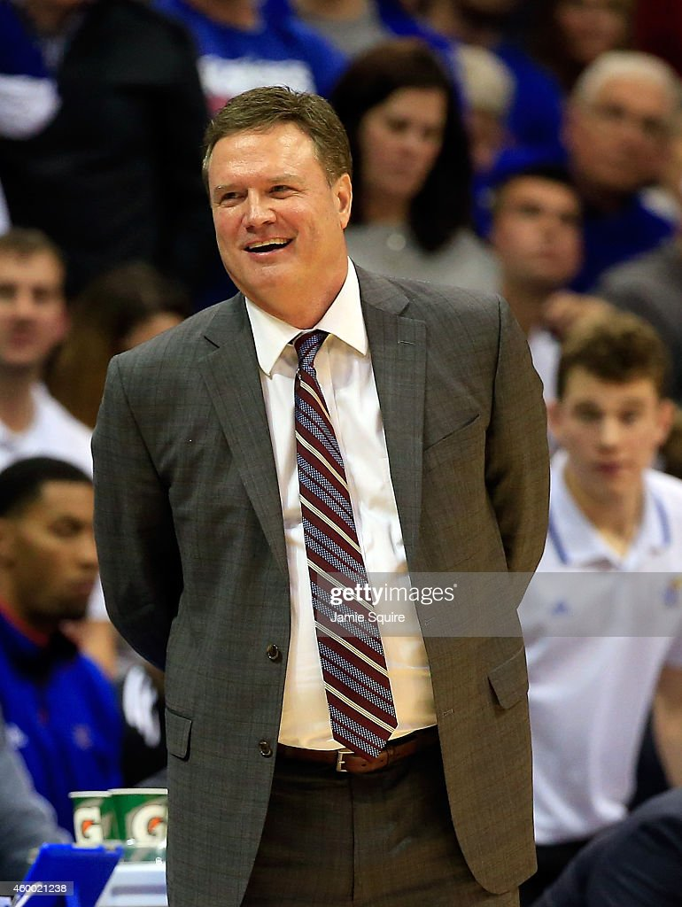 Head coach <a gi-track='captionPersonalityLinkClicked' href=/galleries/search?phrase=Bill+Self+-+Coach&family=editorial&specificpeople=228699 ng-click='$event.stopPropagation()'>Bill Self</a> of the Kansas Jayhawks smiles from the bench during the game against the Florida Gators at Allen Fieldhouse on December 5, 2014 in Lawrence, Kansas.