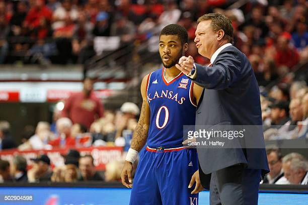 Head coach Bill Self of the Kansas Jayhawks talks to Frank Mason III of the Kansas Jayhawks during the second half of a game against the San Diego...