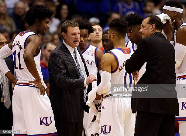 Head coach Bill Self of the Kansas Jayhawks talks to player during a timeout during the game against the Kansas State Wildcats at Allen Fieldhouse on...