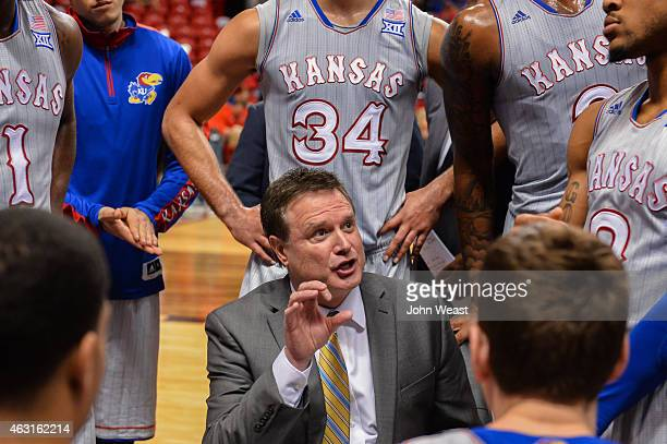Head coach Bill Self of the Kansas Jayhawks talks with his team during a timeout against the Texas Tech Red Raiders on February 10 2015 at United...