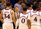 Head coach Bill Self of the Kansas Jayhawks talks with players during a timeout in the game against the Florida Gators at Allen Fieldhouse on...