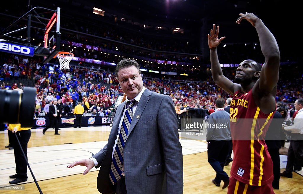 Head coach <a gi-track='captionPersonalityLinkClicked' href=/galleries/search?phrase=Bill+Self+-+Treinador&family=editorial&specificpeople=228699 ng-click='$event.stopPropagation()'>Bill Self</a> of the Kansas Jayhawks walks off of the court as Dustin Hogue #22 of the Iowa State Cyclones celebrates their 70 to 66 win over the Jayhawks during the championship game of the Big 12 Basketball Tournament at Sprint Center on March 14, 2015 in Kansas City, Missouri.