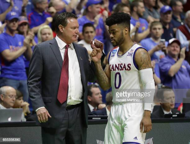 Head coach Bill Self speaks with Frank Mason III of the Kansas Jayhawks against the Michigan State Spartans during the second round of the 2017 NCAA...