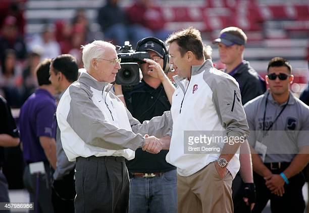 Head coach Bill Snyder of the Kansas State Wildcats and head coach Bob Stoops of the Oklahoma Sooners meet before the game October 18 2014 at Gaylord...