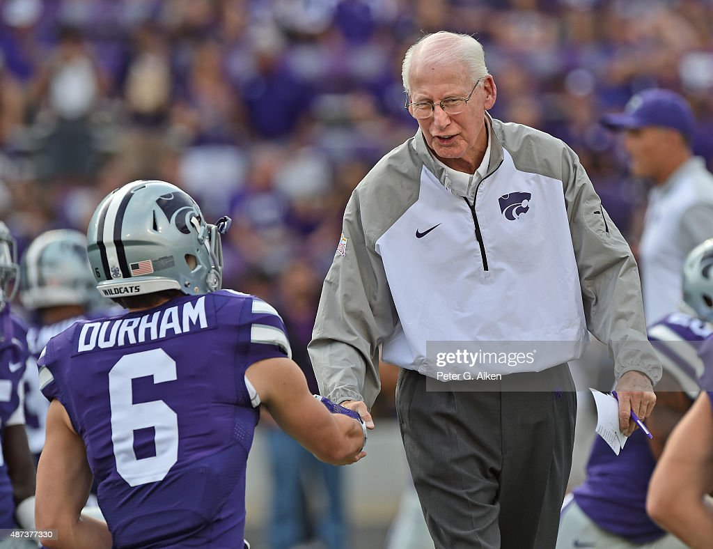 Head coach Bill Snyder (R) of the Kansas State Wildcats greets defensive back Johnathan Durham #6 prior to a game against the South Dakota Coyotes on September 5, 2015 at Bill Snyder Family Stadium in Manhattan, Kansas.