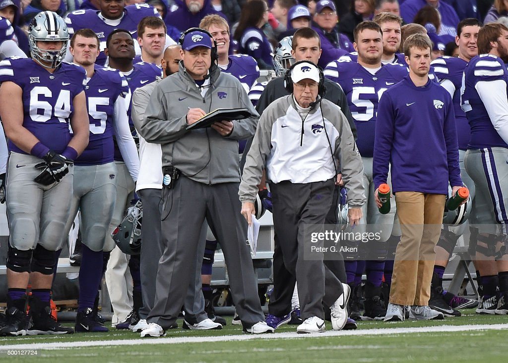 Head coach Bill Snyder (C) of the Kansas State Wildcats looks on from the sideline against the West Virginia Mountaineers during the first half on December 5, 2015 at Bill Snyder Family Stadium in Manhattan, Kansas.