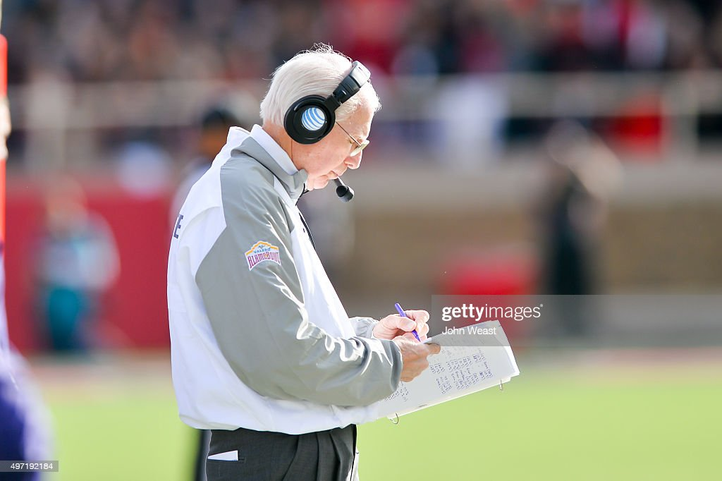 Head coach Bill Snyder of the Kansas State Wildcats makes notes during the game against the Texas Tech Red Raiders on November 14, 2015 at Jones AT&T Stadium in Lubbock, Texas. Texas Tech won the game 59-44.
