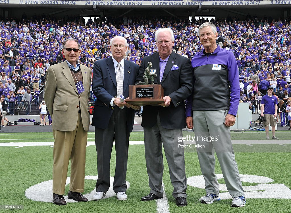 Head coach Bill Snyder (2L) of the Kansas State Wildcats receives the 2012 Bobby Dodd Coach of the Year award from Jim Terry (2R) at half-time of the Purple and White Spring Game on April 27, 2013 at Bill Snyder Family Stadium in Manhattan, Kansas.