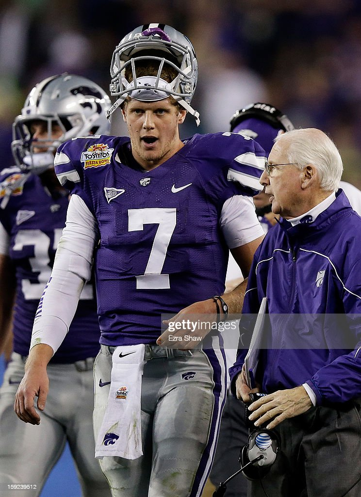Head coach Bill Snyder talks to Collin Klein #7 of the Kansas State Wildcats during the Tostitos Fiesta Bowl against the Oregon Ducks at University of Phoenix Stadium on January 3, 2013 in Glendale, Arizona.