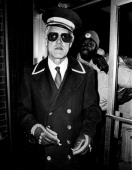 Head coach Bill Walsh of San Francisco 49ers dresses as a Hotel Bellman as he arrived in Detroit ahead of the team charter circa 1986 Detroit Michigan