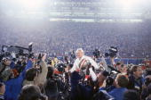 Head coach Bill Walsh of the San Francisco 49ers enjoys a victory ride on the field after defeating the Miami Dolphins 3816 in Super Bowl XIX at...