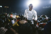 Head Coach Bill Walsh of the San Francisco 49ers is carried off the field on the shoulders of two of his players after the 49ers defeated the Miami...