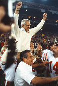 Head Coach Bill Walsh of the San Francisco 49ers is carried on the shoulders of two of his players after the 49ers defeated the Cincinnati Bengals in...