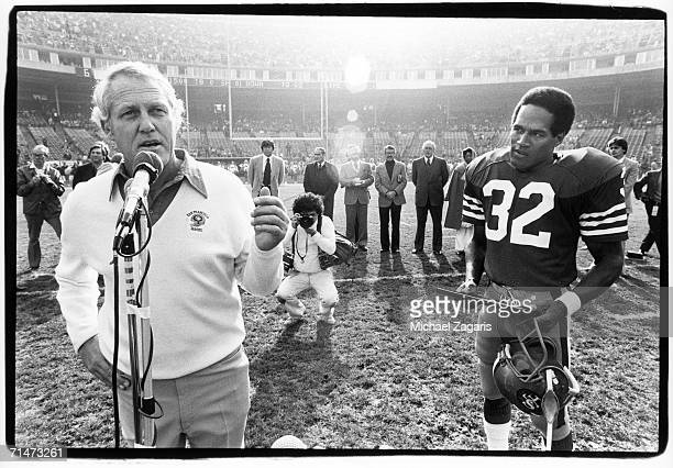 Head coach Bill Walsh of the San Francisco 49ers speaks during a pregame ceremony before the final home game of running back OJ Simpson against the...