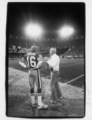 Head coach Bill Walsh of the San Francisco 49ers talks to Joe Montana during the game against the Dallas Cowboys at Candlestick Park on December 19...