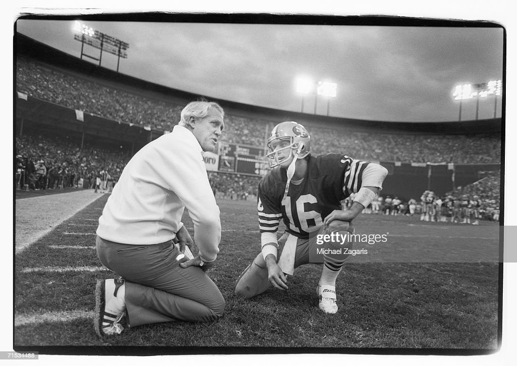 Head coach Bill Walsh of the San Francisco 49ers talks to quarterback Joe Montana during the 1984 NFC Championship Game against the Chicago Bears at...
