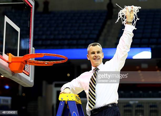 Head coach Billy Donovan of the Florida Gators cuts the net after defeating the Dayton Flyers 6252 in the south regional final of the 2014 NCAA Men's...
