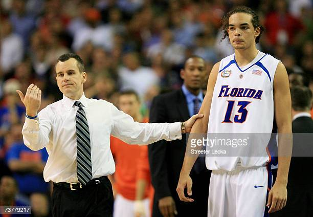 Head coach Billy Donovan of the Florida Gators grabs Joakim Noah during their game against the Ohio State Buckeyes during the NCAA Men's Basketball...