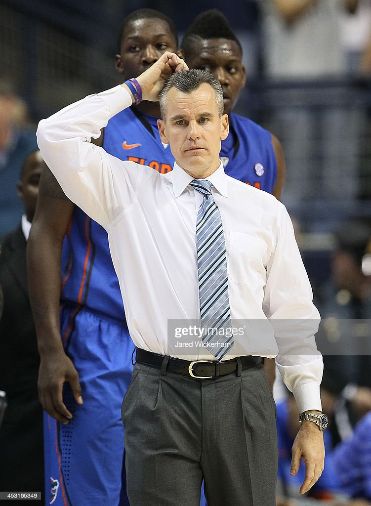 Head coach Billy Donovan of the Florida Gators looks on during an injury timeout in the second half against the Connecticut Huskies during the game at Harry A. Gampel Pavilion on December 2, 2013 in Storrs, Connecticut.