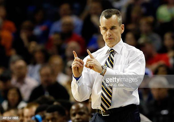 Head coach Billy Donovan of the Florida Gators motions to his players during the south regional final of the 2014 NCAA Men's Basketball Tournament...