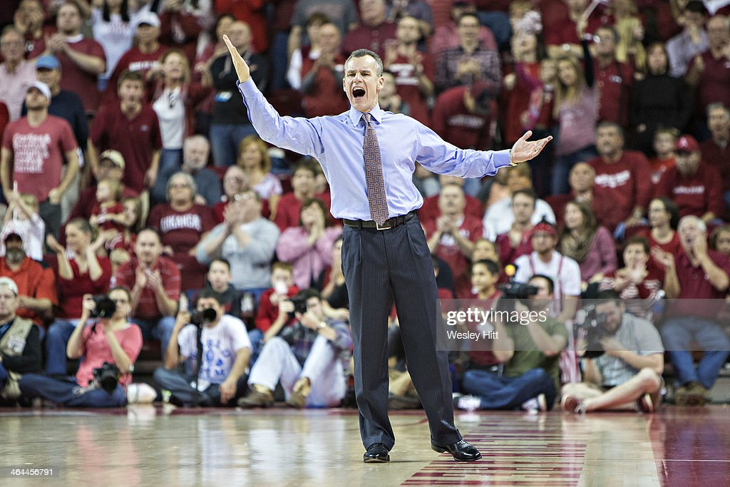 Head Coach Billy Donovan of the Florida Gators signals to his team during a game against the Arkansas Razorbacks at Bud Walton Arena on January 11, 2014 in Fayetteville, Arkansas. The Gators defeated the Razorbacks 84-82.