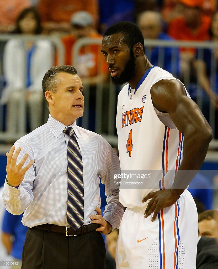 Head coach Billy Donovan of the Florida Gators speaks with Patric Young #4 during the game against the Arkansas Little Rock Trojans at Stephen C. O'Connell Center on November 16, 2013 in Gainesville, Florida.