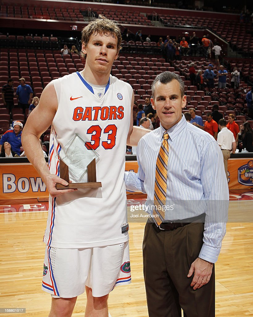 Head Coach Billy Donovan poses with Erik Murphy #33 of the Florida Gators after he won the MVP award for the game against the Air Force Falcons at the MetroPCS Orange Bowl Basketball Classic on December 29, 2012 at the BB&T Center in Sunrise, Florida. The Gators defeated the Falcons 78-61.