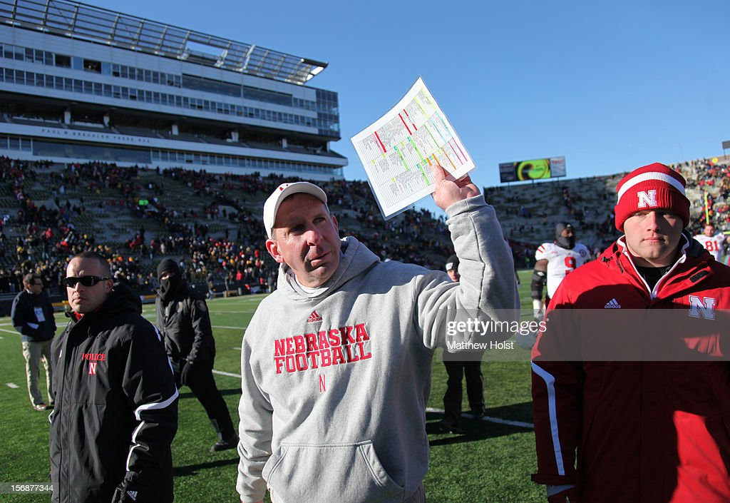 Head coach Bo Pelini of the Nebraska Cornhuskers waves to the crowd after the game against the Iowa Hawkeyes on November 23, 2012 at Kinnick Stadium in Iowa City, Iowa. Nebraska defeated Iowa 13-7.