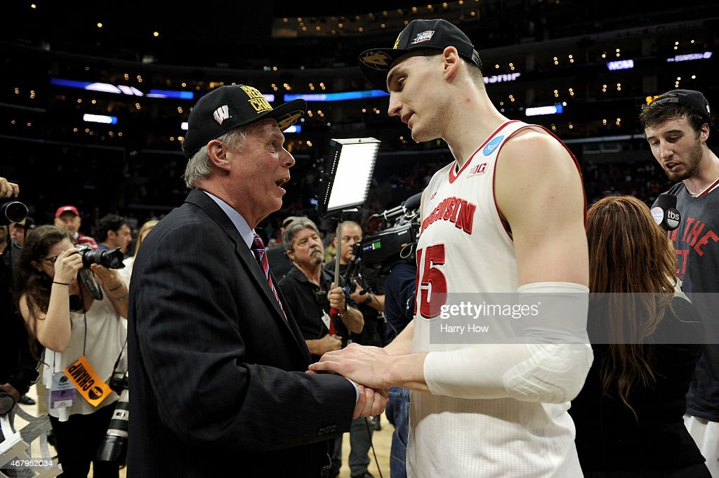 Head coach <a gi-track='captionPersonalityLinkClicked' href=/galleries/search?phrase=Bo+Ryan&family=editorial&specificpeople=198945 ng-click='$event.stopPropagation()'>Bo Ryan</a> and <a gi-track='captionPersonalityLinkClicked' href=/galleries/search?phrase=Sam+Dekker&family=editorial&specificpeople=7887140 ng-click='$event.stopPropagation()'>Sam Dekker</a> #15 of the Wisconsin Badgers celebrate after the Badgers 85-78 victory against the Arizona Wildcats during the West Regional Final of the 2015 NCAA Men's Basketball Tournament at Staples Center on March 28, 2015 in Los Angeles, California.