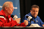 Head coach Bo Ryan of the Wisconsin Badgers and head coach John Calipari of the Kentucky Wildcats address the media during a press conference before...