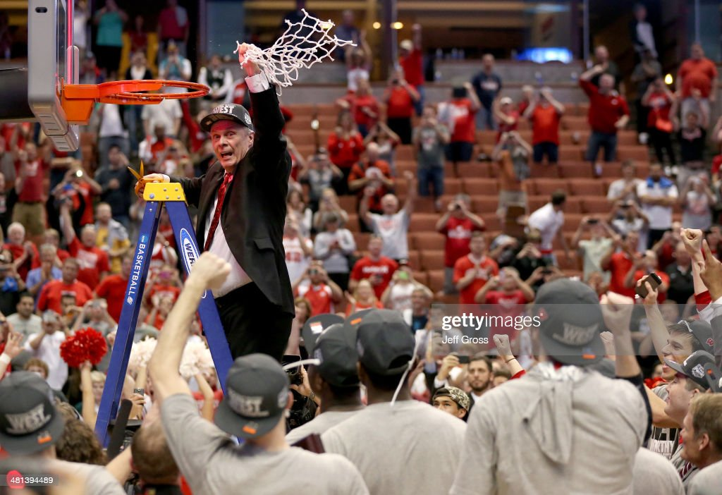 Head coach <a gi-track='captionPersonalityLinkClicked' href=/galleries/search?phrase=Bo+Ryan&family=editorial&specificpeople=198945 ng-click='$event.stopPropagation()'>Bo Ryan</a> of the Wisconsin Badgers celebrates after he cuts down the net after defeating the Arizona Wildcats 64-63 in overtime during the West Regional Final of the 2014 NCAA Men's Basketball Tournament at the Honda Center on March 29, 2014 in Anaheim, California.