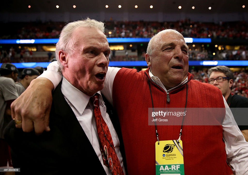 Head coach <a gi-track='captionPersonalityLinkClicked' href=/galleries/search?phrase=Bo+Ryan&family=editorial&specificpeople=198945 ng-click='$event.stopPropagation()'>Bo Ryan</a> of the Wisconsin Badgers celebrates with Director of Athletics <a gi-track='captionPersonalityLinkClicked' href=/galleries/search?phrase=Barry+Alvarez&family=editorial&specificpeople=239480 ng-click='$event.stopPropagation()'>Barry Alvarez</a> after defeating the Arizona Wildcats 64-63 in overtime during the West Regional Final of the 2014 NCAA Men's Basketball Tournament at the Honda Center on March 29, 2014 in Anaheim, California.