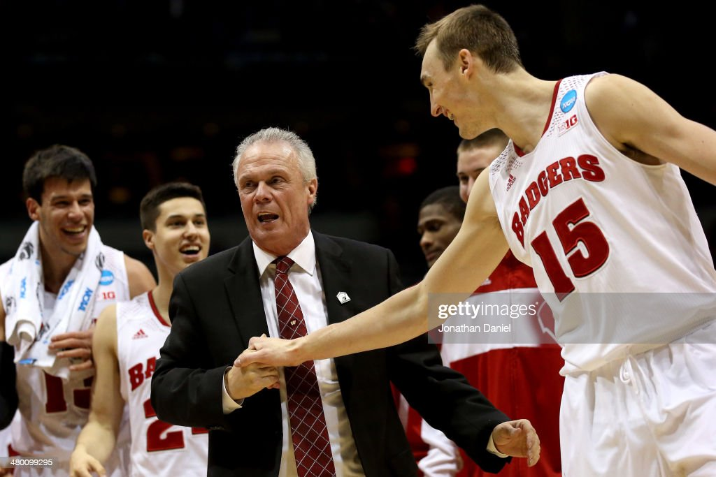 Head coach Bo Ryan of the Wisconsin Badgers celebrates with Sam Dekker after defeating the Oregon Ducks during the third round of the 2014 NCAA Men's...