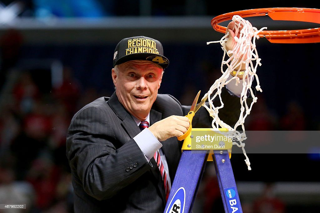 Head coach <a gi-track='captionPersonalityLinkClicked' href=/galleries/search?phrase=Bo+Ryan&family=editorial&specificpeople=198945 ng-click='$event.stopPropagation()'>Bo Ryan</a> of the Wisconsin Badgers cuts the net after the Badgers 85-78 victory against the Arizona Wildcats during the West Regional Final of the 2015 NCAA Men's Basketball Tournament at Staples Center on March 28, 2015 in Los Angeles, California.