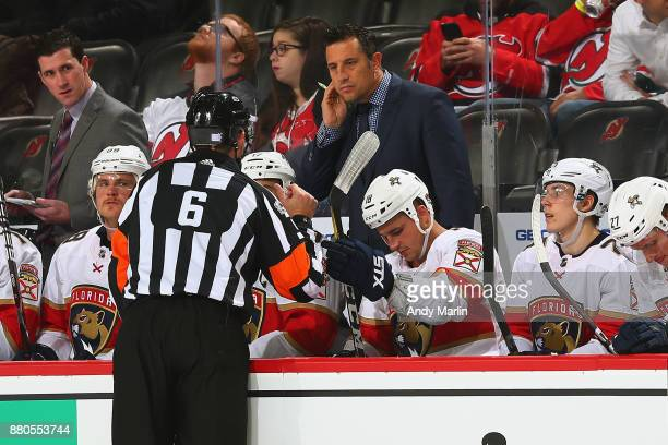 Head Coach Bob Boughner of the Florida Panthers chats with Referee Francis Charron during the game against the New Jersey Devils at Prudential Center...