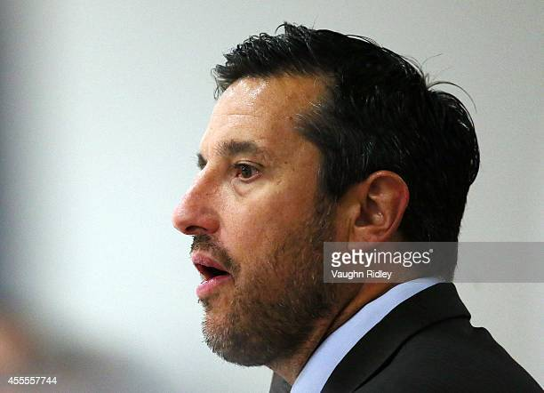 Head Coach Bob Boughner of the Windsor Spitfiers looks on from the bench in the game against the Niagara Ice Dogs at Thorold Arena on September 16...