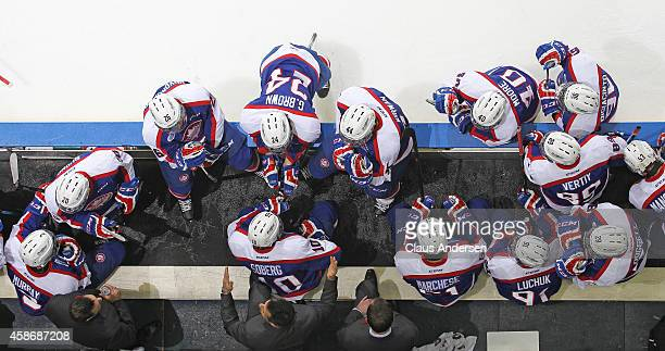 Head coach Bob Boughner of the Windsor Spitfires goes over a play during a timeout against the London Knights in an OHL game at Budweiser Gardens on...