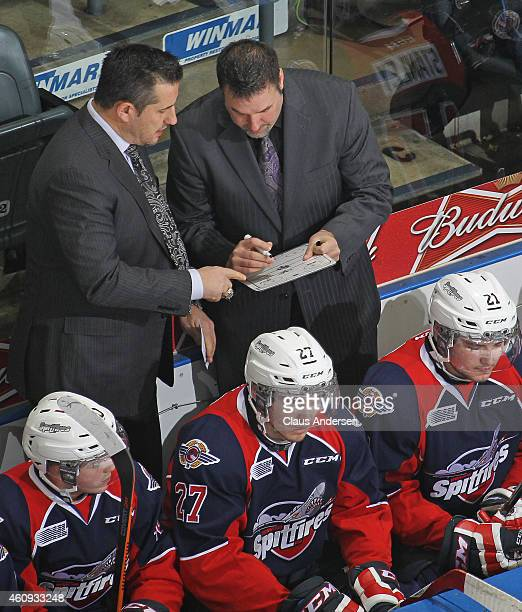 Head coach Bob Boughner of the Windsor Spitfires goes over a play with assistant coach Bob Jones against the London Knights in an OHL game at...