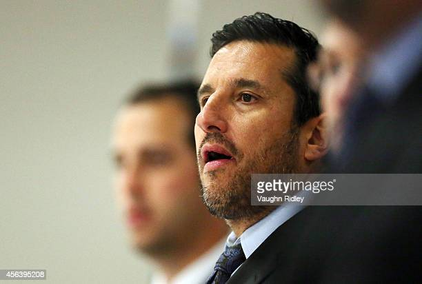 Head Coach Bob Boughner of the Windsor Spitfires looks on from the bench during a preseason OHL game against the Niagara Ice Dogs at Thorold Arena on...