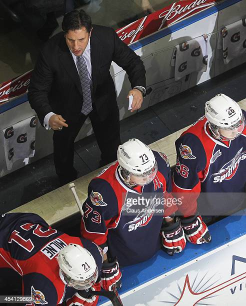 Head coach Bob Boughner of the Windsor Spitfires shouts instructions against the London Knights during an OHL game at the Budweiser Gardens on...