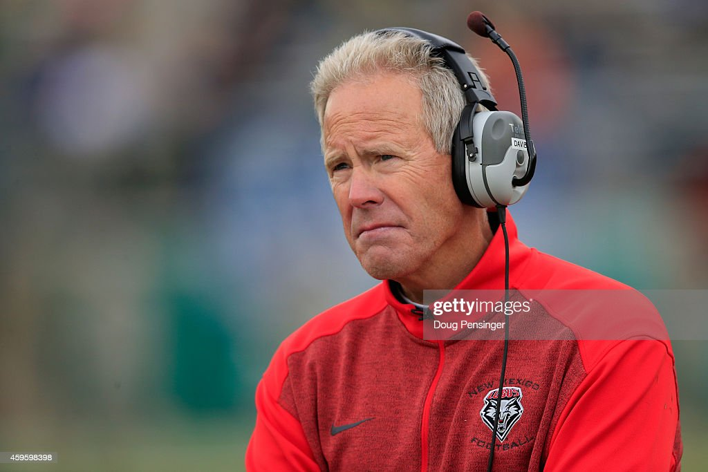 Head coach <a gi-track='captionPersonalityLinkClicked' href=/galleries/search?phrase=Bob+Davie+-+American+Football+Coach&family=editorial&specificpeople=3356902 ng-click='$event.stopPropagation()'>Bob Davie</a> of the New Mexico Lobos leads his team against the Colorado State Rams on November 22, 2014 in Fort Collins, Colorado. Colorado State defeated New Mexico 58-20.