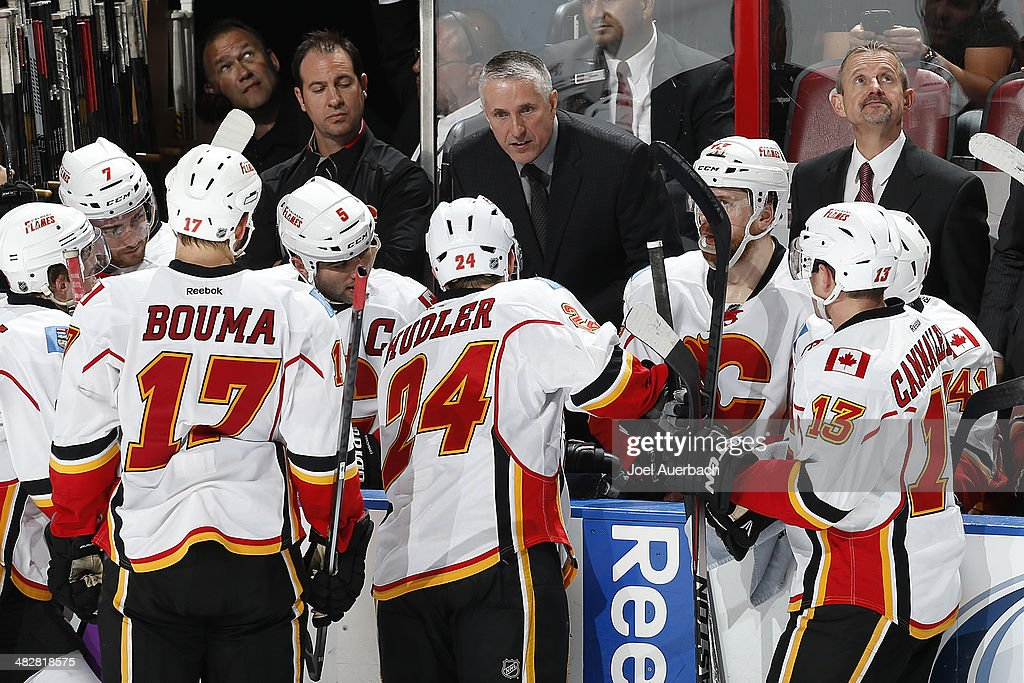 Head coach <a gi-track='captionPersonalityLinkClicked' href=/galleries/search?phrase=Bob+Hartley&family=editorial&specificpeople=206645 ng-click='$event.stopPropagation()'>Bob Hartley</a> of the Calgary Flames directs the players during a time out against the Florida Panthers at the BB&T Center on April 4, 2014 in Sunrise, Florida. The Flames defeated the Panthers 2-1.